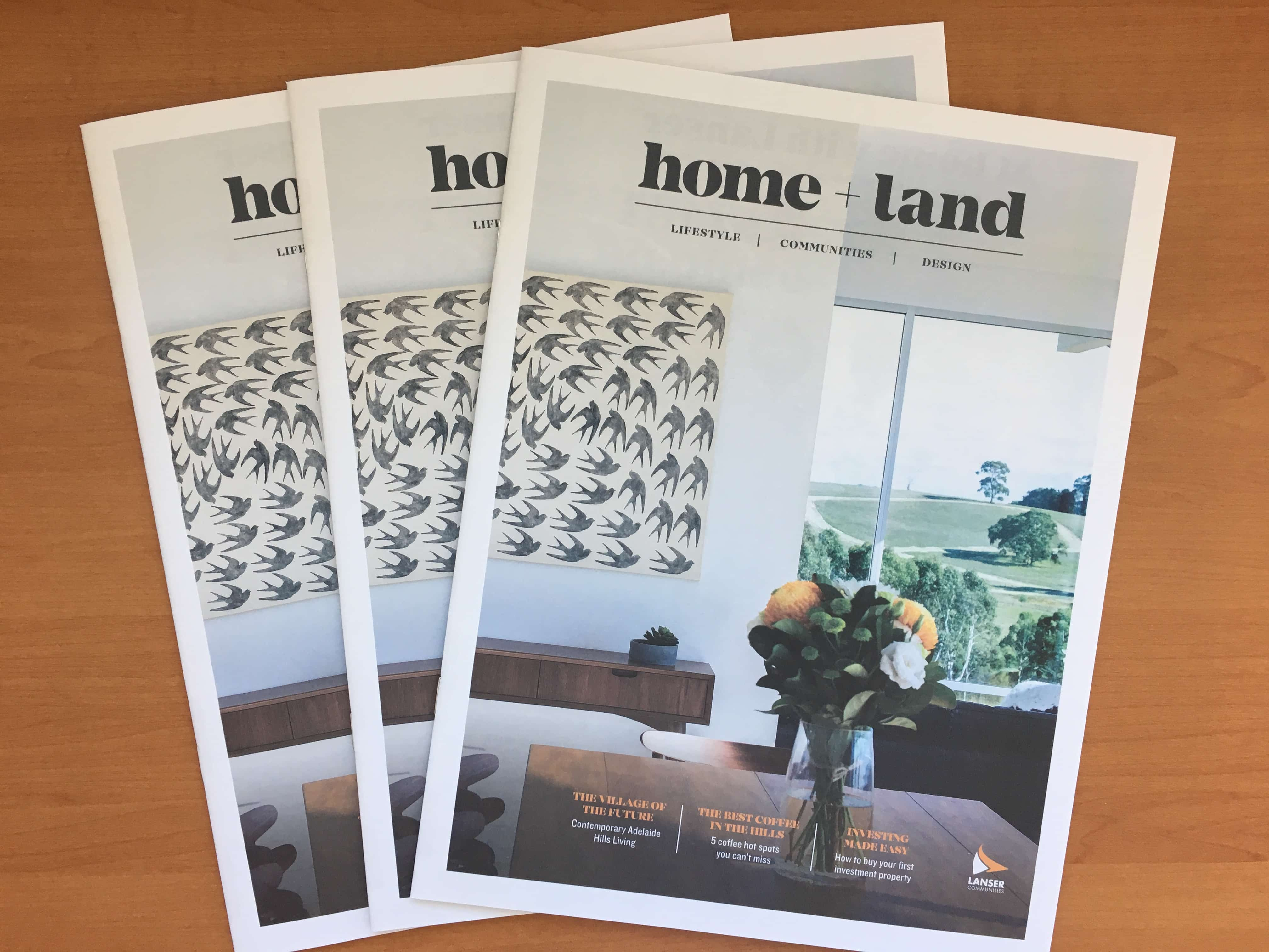 Home & Land Magazine on Table